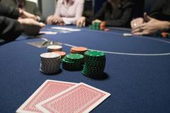 Playing cards with stacks of gambling chips on a casino table Stock Photos
