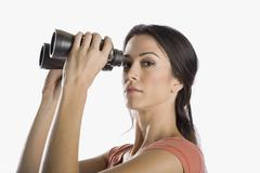 A woman looking through binoculars Stock Photos