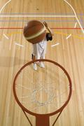 A basketball being shot in a basketball hoop - stock photo