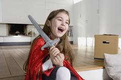 A little girl wearing fancy dress and laughing - stock photo