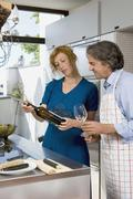 Stock Photo of A couple preparing dinner