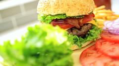 Burger Bun Filled Minced Beef Fresh Salad Vegetables Close Up - stock footage