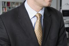 Midsection of a businessman - stock photo