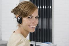 A woman wearing a telephone headset - stock photo