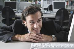 Stock Photo of A businessman resting on his desk