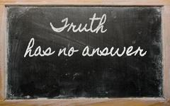 Expression -  truth has no answer - written on a school blackboard with chalk Stock Photos