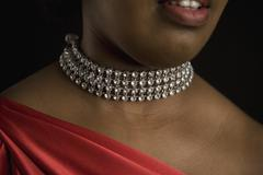 A woman wearing a diamond necklace Stock Photos