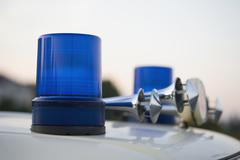 Blue lights and car horns on the roof of a police vehicle - stock photo