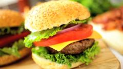 Crunchy Fresh Salad Vegetables Making Classic Cheeseburger - stock footage