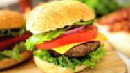 Stock Video Footage of Crunchy Fresh Salad Vegetables Making Classic Cheeseburger