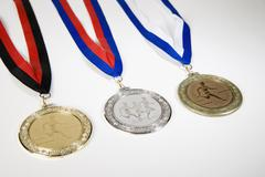 Studio shot of a gold medal, silver medal and a bronze medal Stock Photos