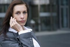 A business woman on her mobile phone Stock Photos