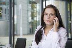 A woman using her mobile phone Stock Photos