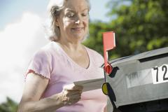 A senior woman checking the mailbox Stock Photos