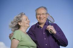 A senior couple with a tennis racket Stock Photos