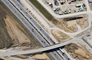 Aerial view of a construction site and motorway Stock Photos