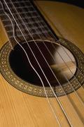 A guitar with a broken string Stock Photos