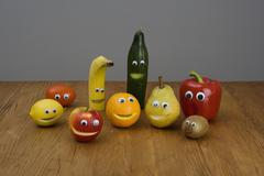 Fruit with anthropomorphic faces - stock photo