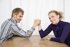 A couple arm wrestling Stock Photos