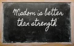 Stock Illustration of expression -  wisdom is better than strength - written on a school blackboard