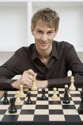 A man playing chess Stock Photos