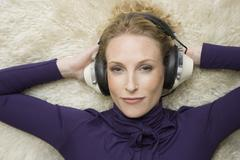 A woman wearing old-fashioned headphones Stock Photos