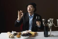 Stereotypical French man with stereotypical french food - stock photo