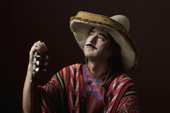 Stock Photo of Stereotypical Mexican man staring off into space with a dreamy expression