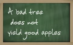 """ a bad tree does not yield good apples "" written on a blackboard Stock Photos"