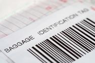 Stock Photo of Close up of a baggage identification tag