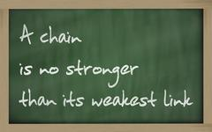"""  a chain is no stronger than its weakest link "" written on a blackboard - stock photo"
