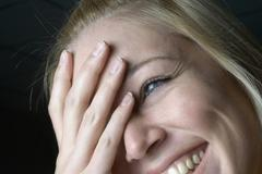 Portrait of a woman laughing, close up Stock Photos