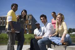 University students socializing and studying on campus - stock photo