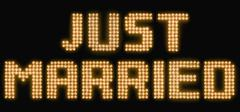 The words just married in illuminated light bulbs Stock Photos