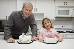 Grandfather celebrating a birthday with his granddaughter Stock Photos
