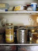 Refrigerator shelves full of food Stock Photos
