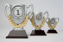 First, second and third place trophies in diminishing perspective Stock Photos