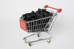 A miniature shopping cart full of computer keys Stock Photos