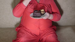 Fat woman watching television while dining - stock footage