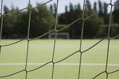 A soccer goal post net, close-up Stock Photos