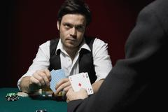 Stock Photo of Two men playing poker at a high stakes game