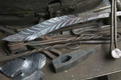 Pieces of crafted metal and metalwork tools Stock Photos