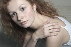 Portrait of a young woman with red hair Stock Photos