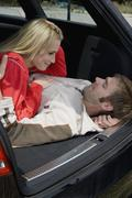 Stock Photo of A couple lying together in the back of a car