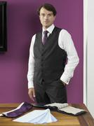 A tailor standing with fabric swatches Stock Photos