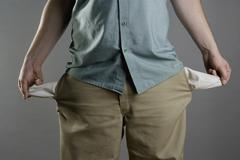 A man showing his empty pockets Stock Photos