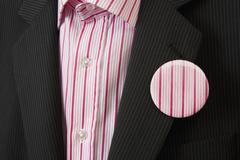 A person wearing a striped badge Stock Photos
