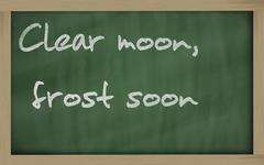 "Stock Photo of "" clear moon, frost soon "" written on a blackboard"