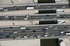 Aerial view of vehicles driving along a motorway Stock Photos