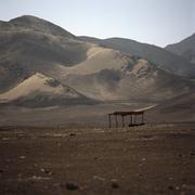 Stock Photo of A hut in a barren landscape